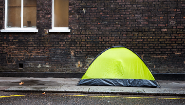 Yellow tent pitched on a street