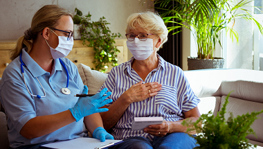 Healthcare worker and patient having a discussion