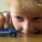 child with toy car, NICE guideline to tackle air pollution