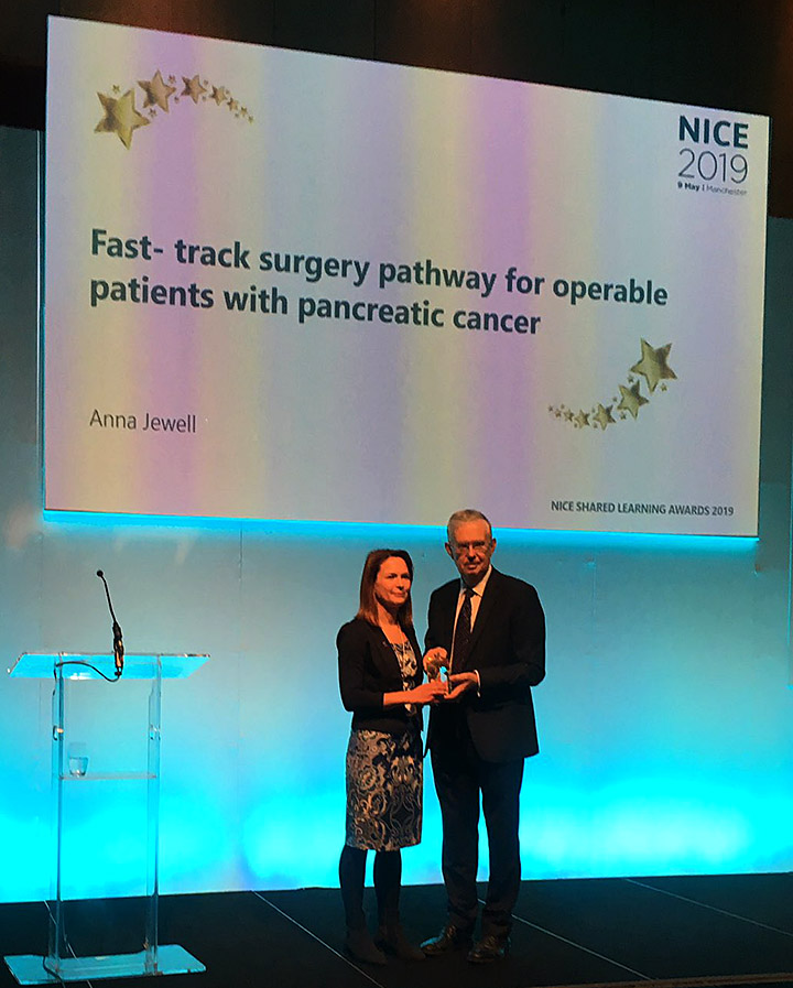 Shared Learning award 2019 winner: Anna Jewell, director of services, Research and Influencing, Pancreatic Cancer UK, receiving the award from Sir David Haslam, NICE Chair